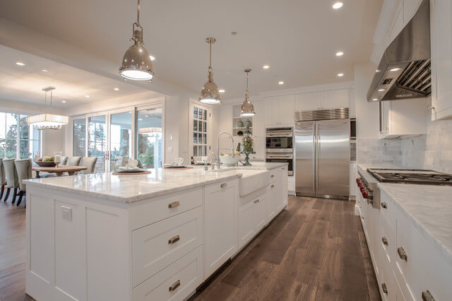 White Farmhouse Kitchen with Wood Floors and Silver Fixtures