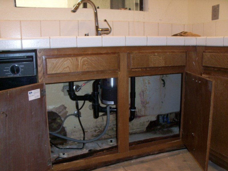 water damage in cabinets